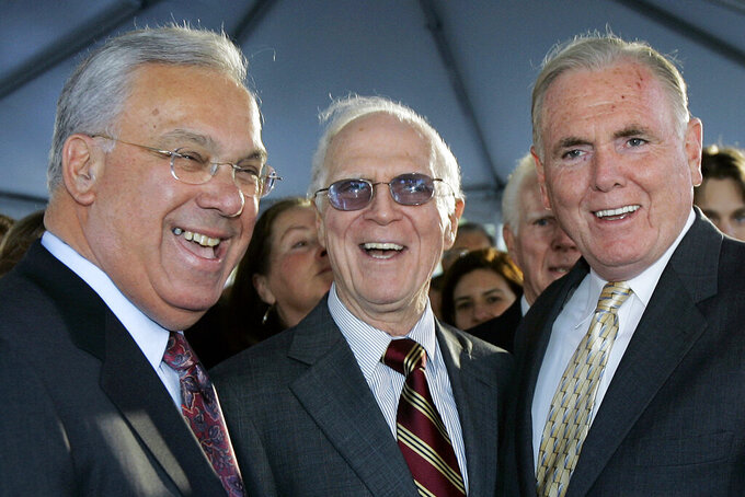 FILE - In this Nov. 1, 2006, file photo, former Boston Mayors Thomas Menino, left, Kevin White, center, and Raymond Flynn pose together prior to the unveiling of a bronze statue bearing White's likeness in Boston. The three men occupied the Boston mayor's office from 1968–2014. Boston is facing a historic political pivot with the expected departure of Mayor Marty Walsh to become President Joe Biden's labor secretary. When Walsh leaves, the city will see the elevation of the first woman and first Black Bostonian to the mayor's office with City Council President Kim Janey stepping in on an interim basis. (AP Photo/Elise Amendola, File)