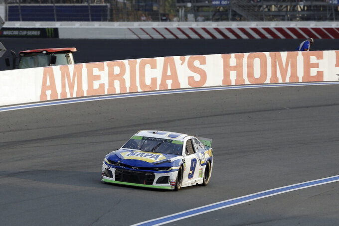 Chase Elliott drives through Turn 2 during the NASCAR Cup Series auto race at Charlotte Motor Speedway in Concord, N.C., Sunday, Sept. 29, 2019. (AP Photo/Gerry Broome)