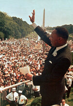 FILE - In this Aug. 28, 1963, file photo, the Rev. Martin Luther King Jr. acknowledges the crowd at the Lincoln Memorial for his