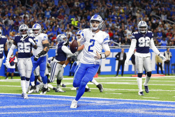 Detroit Lions quarterback Jeff Driskel (2) runs for a 2-yard touchdown during the first half of an NFL football game against the Dallas Cowboys, Sunday, Nov. 17, 2019, in Detroit. (AP Photo/Paul Sancya)