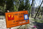 In this June 12, 2019 photo, a sign for a prescribed burn in the Giant Sequoia National Monument, Calif., remains posted two years after the fire. The prescribed burn, a low-intensity, closely managed fire, was intended to clear out undergrowth and protect the heart of Kings Canyon National Park from a future threatening wildfire. The tactic is considered one of the best ways to prevent the kind of catastrophic destruction that has become common, but its use falls woefully short of goals in the West. (AP Photo/Brian Melley)