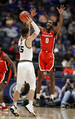 Georgia guard William Jackson II (0) defends against Missouri guard Jordan Geist (15) in the first half of an NCAA college basketball game at the Southeastern Conference tournament, Wednesday, March 13, 2019, in Nashville, Tenn. (AP Photo/Mark Humphrey)