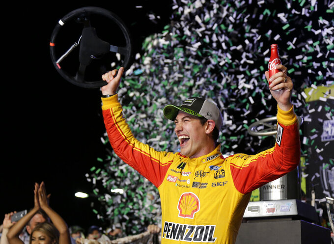 FILE- In this Nov. 18, 2018, file photo Joey Logano waves his steering wheel as confetti flies after winning the NASCAR Cup Series Championship auto race at the Homestead-Miami Speedway in Homestead, Fla. The reset button on NASCAR was triggered as soon as Joey Logano wrapped last year's championship celebration. There was massive work to be done on stabilizing the stock-car series from a downward spiral speeding toward the bottom and the fix is nothing short of a radical reboot. (AP Photo/Terry Renna, File)