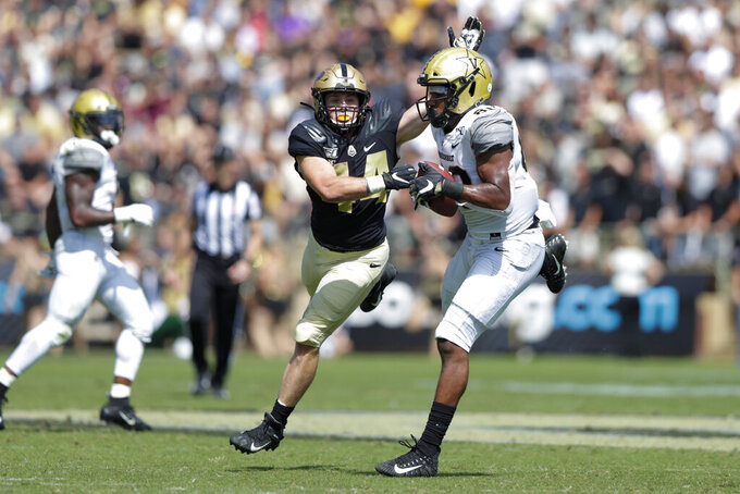 Vanderbilt tight end Jared Pinkney, right, makes a catch in front of Purdue linebacker Ben Holt, left, during the first half of an NCAA college football game in West Lafayette, Ind., Saturday, Sept. 7, 2019. (AP Photo/Michael Conroy)