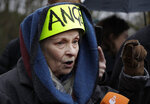 British fashion designer Vivienne Westwood speaks with the media as she attends a protest against the extradition of Wikileaks founder Julian Assange outside Belmarsh Magistrates Court in London, Monday, Feb. 24, 2020. The U.S. government and WikiLeaks founder Julian Assange will face off Monday in a high-security London courthouse, a decade after WikiLeaks infuriated American officials by publishing a trove of classified military documents. (AP Photo/Matt Dunham)