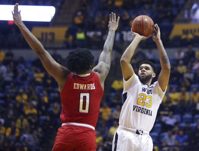 West Virginia forward Esa Ahmad (23) shoots while defended by Texas Tech guard Kyler Edwards (0) during the second half of an NCAA college basketball game Wednesday, Jan. 2, 2019, in Morgantown, W.Va. Texas Tech defeated West Virginia 62-59. (AP Photo/Raymond Thompson)