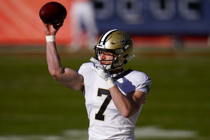New Orleans Saints quarterback Taysom Hill (7) warms up prior to an NFL football game against the Denver Broncos, Sunday, Nov. 29, 2020, in Denver. (AP Photo/David Zalubowski)