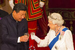 """FILE - In this Tuesday Oct. 20, 2015 file photo, Chinese President Xi Jinping with Britain's Queen Elizabeth II during a state banquet at Buckingham Palace, London, on the first day of the state visit to Britain. Only five years ago, former British Prime Minister David Cameron was celebrating a """"golden era"""" in U.K.-China relations, bonding with President Xi Jinping over a pint of beer at the pub and signing off trade deals worth billions. Those friendly scenes now seem like a distant memory, with hostile rhetoric ratcheting up this week over Beijing's new national security law on Hong Kong. China has threatened """"consequences"""" after Britain offered refuge to millions in the former colony.  (Dominic Lipinski/Pool Photo via AP, File)"""