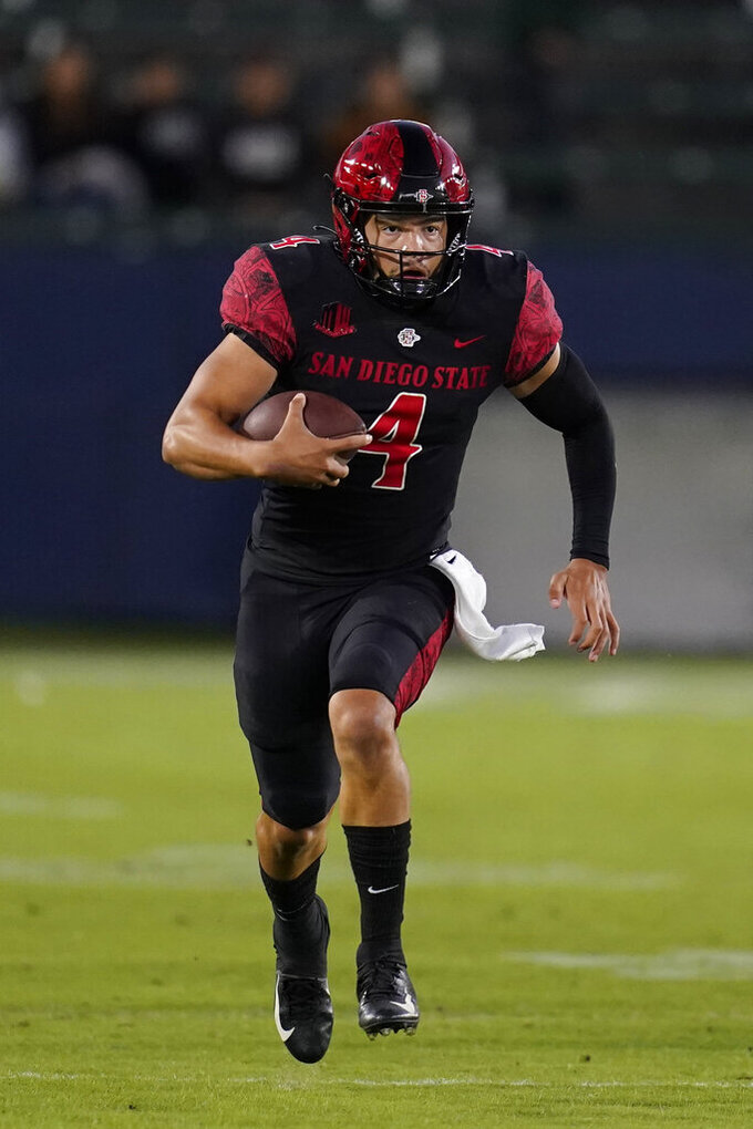 San Diego State quarterback Jordon Brookshire (4) runs the ball during the first half of an NCAA football game against the New Mexico Saturday, Oct. 9, 2021, in Carson, Calif. (AP Photo/Ashley Landis)