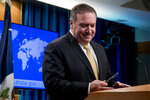 Secretary of State Mike Pompeo, pauses during a news conference at the State Department in Washington, Monday, Nov. 18, 2019. Pompeo spoke about Iran, Iraq, Israeli settlements in the West Bank, protests in Hong Kong, and Bolivia, among other topics. (AP Photo/Andrew Harnik)
