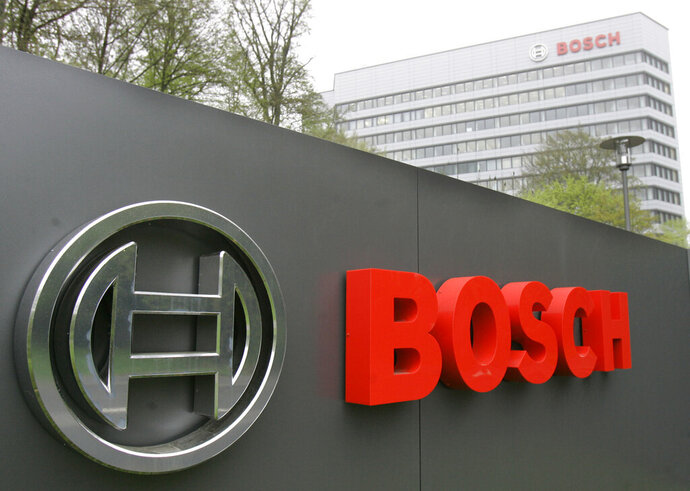 FILE In this April 27, 2006 file photo, the logo of the Robert Bosch GmbH in front of the company's headquarters in Gerlingen near Stuttgart, southwestern Germany. German prosecutors have fined auto components and technology company Robert Bosch GmbH 90 million euros ($100 million) over its role in the diesel emissions scandal that erupted at Volkswagen in 2015.  (AP Photo/Thomas Kienzle, File)