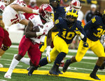 Indiana running back Stevie Scott (21) rushes, defended by Michigan linebacker Devin Bush (10), in the first quarter of an NCAA college football game in Ann Arbor, Mich., Saturday, Nov. 17, 2018. (AP Photo/Tony Ding)