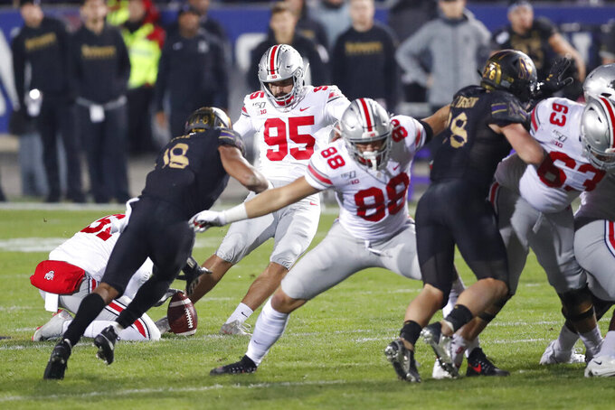 Ohio State placekicker Blake Haubeil (95) boots a 55-yard field goal at the end of the first half of an NCAA college football game against Northwestern, Friday, Oct. 18, 2019, in Evanston, Ill. (AP Photo/Charles Rex Arbogast)