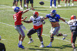 Cleveland Browns defensive tackle Andrew Billings (99) pressures New York Giants quarterback Daniel Jones (8) after beating center Nick Gates (65) during a joint NFL football training camp practice Friday, Aug. 20, 2021, in Berea, Ohio. (AP Photo/Ron Schwane)