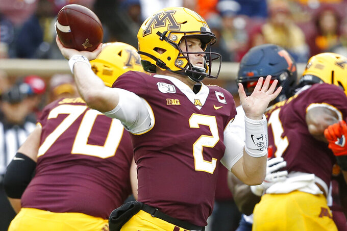 Minnesota quarterback Tanner Morgan (2) passes against Illinois in the first quarter at an NCAA college football game Saturday, Oct. 5, 2019, in Minneapolis. (AP Photo/Bruce Kluckhohn)