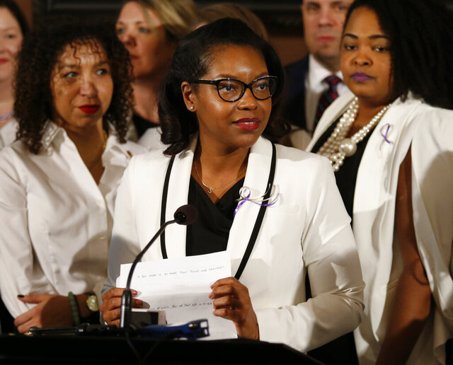 FILE – In this March 5, 2019 file photo, Ohio House minority leader Emilia Sykes delivers the Democrat's response to the Gov. Mike DeWine's State of the State address at the Ohio Statehouse in Columbus, Ohio. Sykes is among a group of Democrats in the state who proposed a resolution Tuesday, June 2, 2020, to declare racism a public health crisis amid protests across the state and nationwide over the death of George Floyd, a black man who died after being restrained by Minneapolis police officers on May 25.  (AP Photo/Paul Vernon, File)