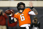 Oklahoma State quarterback Dru Brown (6) throws in the second half of an NCAA college football game against Oklahoma in Stillwater, Okla., Saturday, Nov. 30, 2019. (AP Photo/Sue Ogrocki)