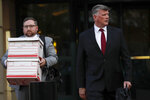 Kevin Downing, right, an attorney representing Lev Parnas and Igor Fruman, leaves the federal courthouse in Alexandria, Va., Thursday, Oct. 10, 2019.(AP Photo/Pablo Martinez Monsivais)