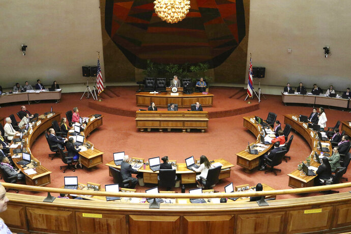 FILE -- This May 2, 2019 file photo shows lawmakers meet on the floor of the state House of Representatives at the Hawaii State Capitol in Honolulu. Attorneys argued before the Hawaii Supreme Court over how much lawmakers should allow the public to weigh in on legislation as laws are being drafted and voted on. (AP Photo/Audrey McAvoy)