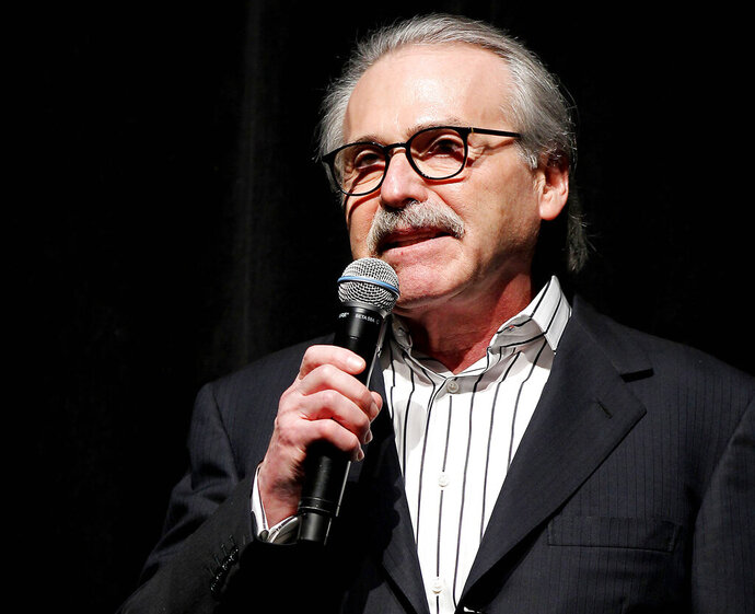 """FILE - In this Jan. 31, 2014 photo, David Pecker, Chairman and CEO of American Media, addresses those attending the Shape & Men's Fitness Super Bowl Party in New York. An attorney for the head of the National Enquirer's parent company says the tabloid didn't commit extortion or blackmail by threatening to publish Amazon CEO Jeff Bezos' explicit photos. Elkan Abramowitz represents American Media Inc. CEO David Pecker. He defended the tabloid's practice as a """"negotiation"""" in an interview Sunday, Feb. 10, 2019, with ABC News. (Marion Curtis via AP, File)"""