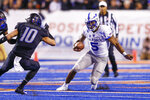 Air Force quarterback Donald Hammond III (5) runs with the ball against the Boise State defense in the first half of an NCAA college football game, Friday, Sept. 20, 2019, in Boise, Idaho. (AP Photo/Steve Conner)