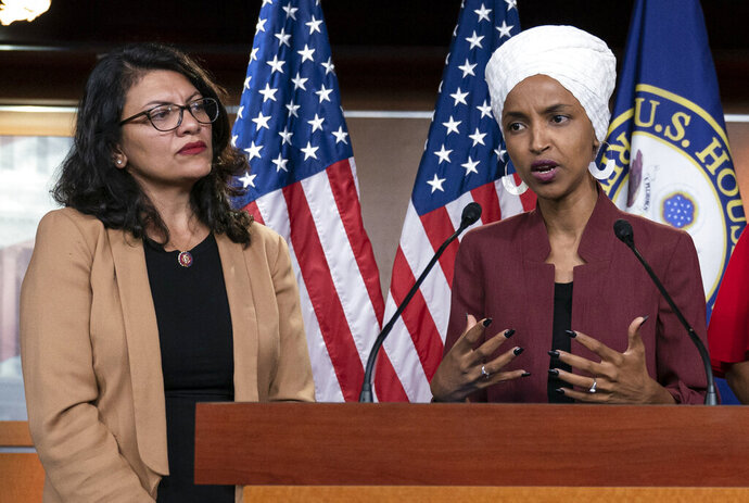 FILE - In this July 15, 2019, file photo, U.S. Rep. Ilhan Omar, D-Minn, right, speaks, as U.S. Rep. Rashida Tlaib, D-Mich. listens, during a news conference at the Capitol in Washington. The U.S. envoy to Israel said he supports Israel's decision to deny entry to two Muslim congresswomen ahead of their planned visit to Jerusalem and the West Bank. Ambassador David Friedman said Thursday, Aug. 15, 2019, in a statement following the Israeli government's announcement that Israel