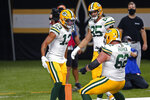 Green Bay Packers wide receiver Allen Lazard (13) celebrates his touchdown reception with offensive guard Lucas Patrick (62) and tight end Robert Tonyan (85) in the first half of an NFL football game in New Orleans, Sunday, Sept. 27, 2020. (AP Photo/Brett Duke)