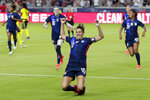 U.S. forward Carli Lloyd (10) slides on the turf after scoring in the first minute against Jamaica during the first half of their 2021 WNT Summer Series soccer match, Sunday, June 13, 2021, in Houston. (AP Photo/Michael Wyke)