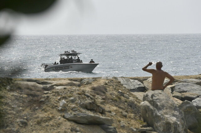 Security forces patrol near the shore in the port city of La Guaira, Venezuela, Sunday, May 3, 2020. Interior Minister Nestor Reverol said on state television that security forces overcame before dawn Sunday an armed maritime incursion with speedboats from neighboring Colombia in which several attackers were killed and others detained. (AP Photo/Matias Delacroix)