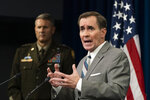 Pentagon spokesman John Kirby with U.S. Army Maj. Gen. William Taylor, Joint Staff Operations, speaks about the situation in Afghanistan during a briefing at the Pentagon in Washington, Friday, Aug. 27, 2021. (AP Photo/Manuel Balce Ceneta)