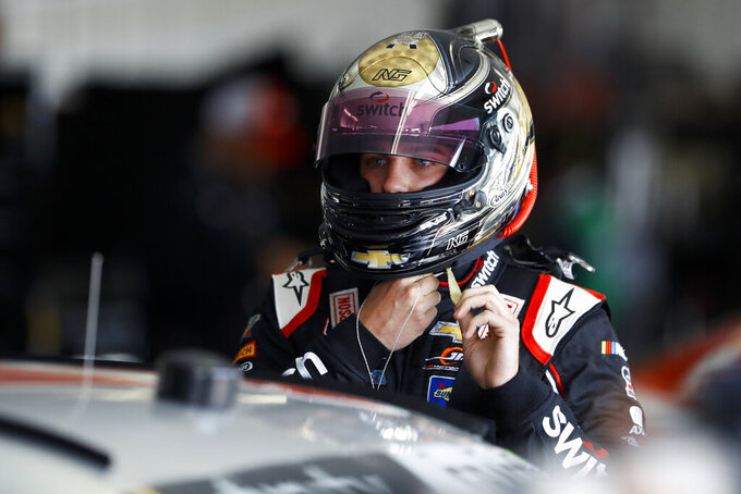 Noah Gragson adjusts his helmet before a practice session for Saturday's NASCAR Xfinity Series auto race at Pocono Raceway, Friday, May 31, 2019, in Long Pond, Pa. (AP Photo/Matt Slocum)