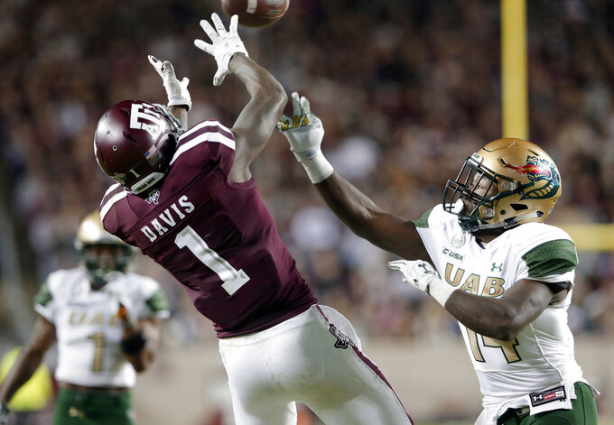 Texas A&M wide receiver Quartney Davis (1) goes up for the reception in front of UAB cornerback Dy'jonn Turner (14) during the first half of an NCAA college football game Saturday, Nov. 17, 2018, in College Station, Texas. (AP Photo/Michael Wyke)