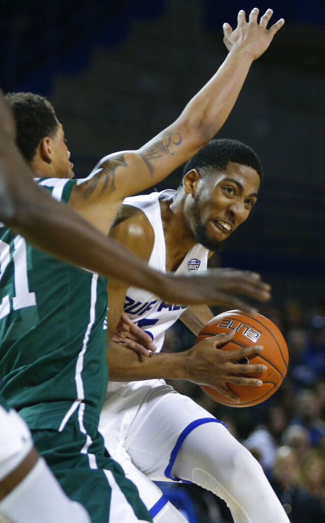 Buffalo guard CJ Massinburg (5) drives against Eastern Michigan during the second half of an NCAA college basketball game, Friday, Jan. 18, 2019, in Buffalo N.Y. (AP Photo/Jeffrey T. Barnes)
