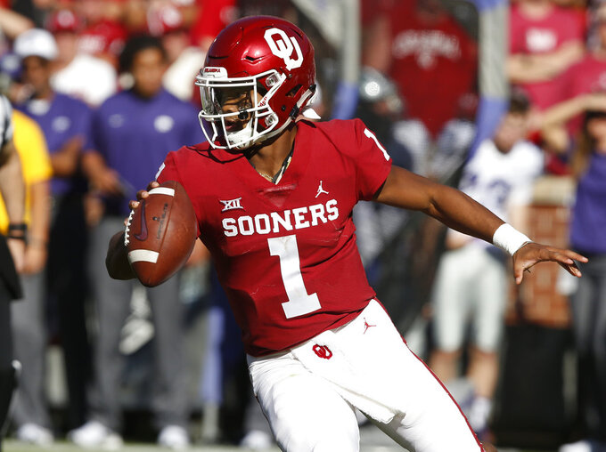 File - In this Oct. 27, 2018, file photo, Oklahoma quarterback Kyler Murray (1) maneuvers during an NCAA college football game against Kansas State in Norman, Okla. What figures to be Murray's one-and-done attempt to get No. 7 Oklahoma back to the College Football Playoff will require a win in an atmosphere significantly more hostile because of a prime-time kickoff. (AP Photo/Sue Ogrocki, File)