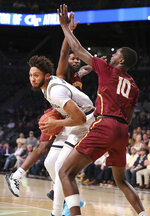 Georgia Tech forward James Banks III, left, drives between Bethune-Cookman defenders Malik Maitland, back left, and Cletrell Pope (10) during an NCAA college basketball game Sunday, Dec. 1, 2019, in Atlanta. (Curtis Compton/Atlanta Journal-Constitution via AP)