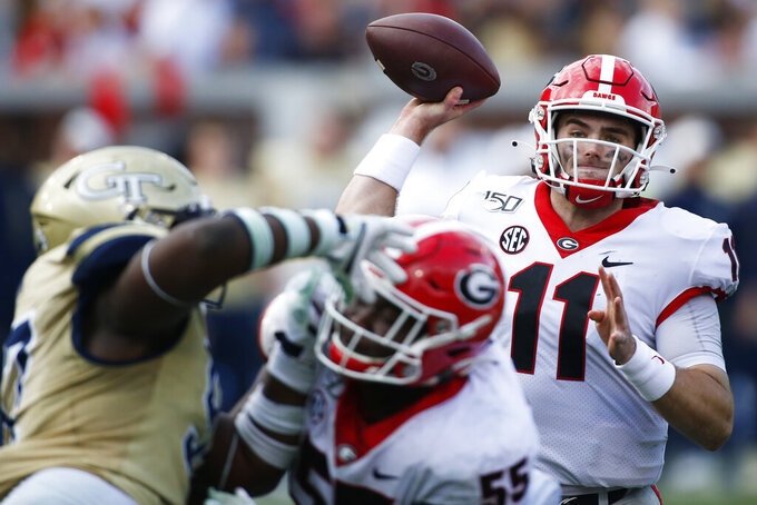 Georgia quarterback Jake Fromm (11) looks to throw a pass in the second half during an NCAA college football game against Georgia Tech, Saturday, Nov. 30, 2019, in Atlanta. (Joshua L. Jones/Athens Banner-Herald via AP)