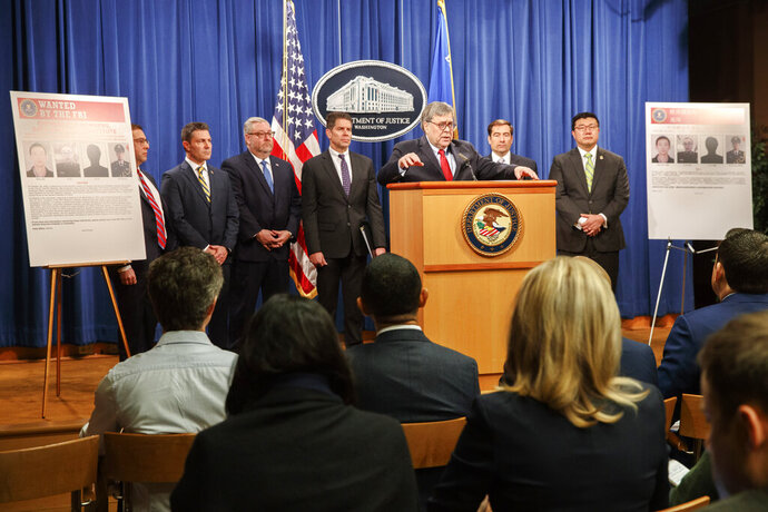 From left, Principal Associate Deputy Attorney General Seth Ducharm, Chris Hacker, Special Agent in Charge of FBI Atlanta, Assistant Attorney General Brian Benczkowski, Attorney General William Barr, Assistant Attorney General John Demers, and U.S. Attorney for the Northern District of Georgia Byung