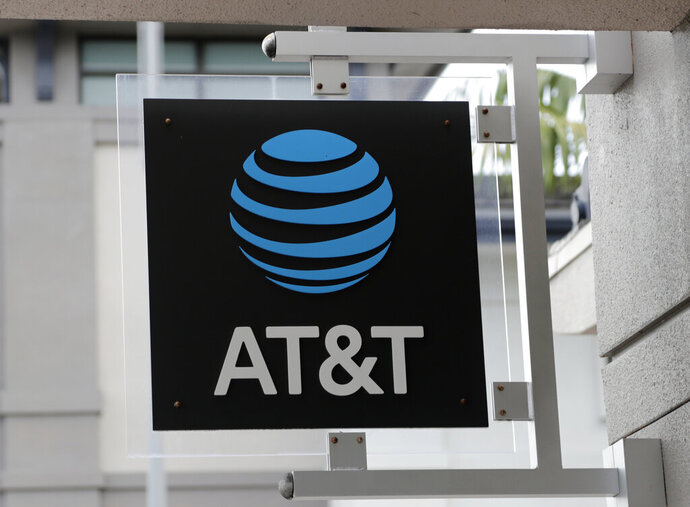 FILE - In this July 18, 2019, file photo, is an AT&T retail store in Miami. AT&T will review its portfolio for assets it can sell off, pay down debt related to its Time Warner acquisition and add two board members as part of a plan to boost results. (AP Photo/Lynne Sladky, File)