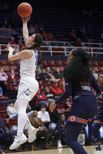 BYU guard Brenna Chase, left, shoots against Auburn forward Unique Thompson during the first half of a first-round game in the NCAA women's college basketball tournament in Stanford, Calif., Saturday, March 23, 2019. (AP Photo/Jeff Chiu)