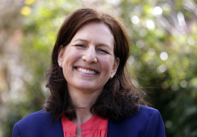 FILE - In this March 30, 2018, file photo, Dr. Kim Schrier, a candidate in Washington state's 8th District race, poses for a photo in Issaquah, Wash. Schrier, a Democrat, is running against Republican Dino Rossi in an open and true toss-up race for the seat to succeed retiring incumbent, Rep. Dave Reichert. The district includes the eastern suburbs of Seattle and stretches into the rural Cascade Mountain region. (AP Photo/Elaine Thompson, File)