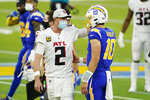 Los Angeles Chargers quarterback Justin Herbert (10) interacts with Atlanta Falcons quarterback Matt Ryan (2) at the end of an NFL football game Sunday, Dec. 13, 2020, in Inglewood, Calif. (AP Photo/Ashley Landis)
