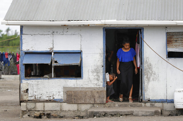 FILE - In this April 7, 2019, file photo, locals prepare to leave their house in Nuku'alofa, Tonga. The largest cluster of places without the coronavirus can be found in the scattered islands of the South Pacific. Tonga, Kiribati, Samoa, Micronesia and Tuvalu are among those small nations yet to report a single case. But that doesn't mean they have been spared from the pandemic's effects. (AP Photo/Mark Baker, File)