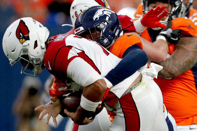 Denver Broncos linebacker Malik Reed sacks Arizona Cardinals quarterback Brett Hundley, left, during the first half of an NFL preseason football game, Thursday, Aug. 29, 2019, in Denver. (AP Photo/David Zalubowski)