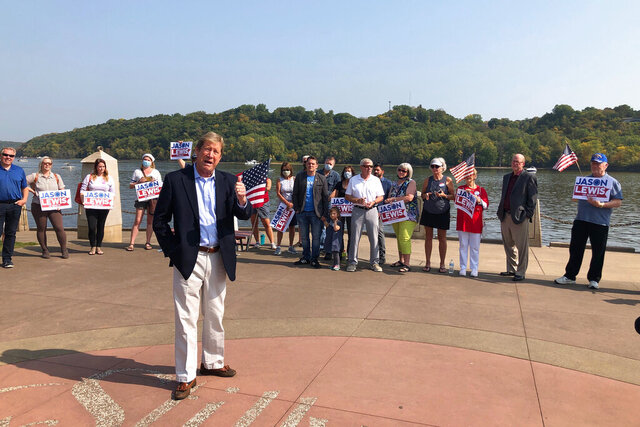 Republican U.S. Senate candidate Jason Lewis addresses supporters in Stillwater, Minn., on Tuesday, Sept. 22, 2020, at a get out the vote rally on the banks of the St. Croix River. Lewis, a one-term former congressman and former talk radio host, is challenging Democratic U.S. Sen. Tina Smith. (AP Photo/Steve Karnowski)