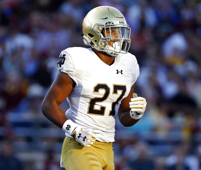 FILE - In this Sept. 16, 2017, file photo, Notre Dame's Julian Love watches during the second half of an NCAA college football game against Boston College in Boston.  Love can't wait to get to Ryan Field. The junior cornerback for No. 3 Notre Dame played his high school football at Nazareth Catholic Academy in suburban Chicago, about 30 miles from the Northwestern campus in Evanston. He will be going up against Northwestern's receivers and talented senior quarterback Clayton Thorson on Saturday night. (AP Photo/Michael Dwyer, File)