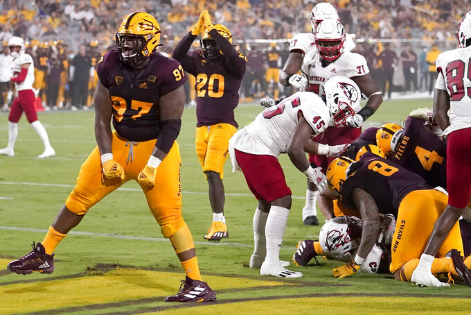 Arizona State defensive lineman Shannon Forman (97) celebrates a defensive stop against Southern Utah during the first half of an NCAA college football game, Thursday, Sept. 2, 2021, in Tempe, Ariz. (AP Photo/Matt York)