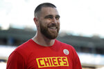 FILE - Kansas City Chiefs' Travis Kelce smiles before the NFL Super Bowl 54 football game between the San Francisco 49ers and Kansas City Chiefs in Miami Gardens Fla., in this Sunday, Feb. 2, 2020, file photo. Seattle's star quarterback Russell Wilson and Kansas City's standout tight end Travis Kelce are among the 32 finalists for the Walter Payton NFL Man of the Year award. (AP Photo/Wilfredo Lee, File)