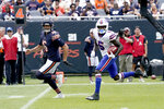Buffalo Bills' Marquez Stevenson (5) returns Chicago Bears punter Pat O'Donnell's punt, right, for a touchdown during the second half of an NFL preseason football game Saturday, Aug. 21, 2021, in Chicago. (AP Photo/David Banks)