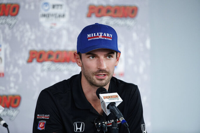 File-This Aug. 17, 2019, file photo shows Alexander Rossi speaking during a news conference for Sunday's IndyCar Series auto race at Pocono Raceway, in Long Pond, Pa. Josef Newgarden has been the IndyCar points leader for all but one race this season and built enough of a cushion that his mindset has changed as the championship race speeds into an anticlimactic final two events of the year. Newgarden leads Team Penske teammate and Indianapolis 500 winner Simon Pagenaud by 38 points, while Rossi is 46 points behind. (AP Photo/Matt Slocum, File)