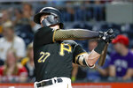 Pittsburgh Pirates' Kevin Newman hits a three-run home run against the Cincinnati Reds in the fifth inning of a baseball game, Friday, Sept. 27, 2019, in Pittsburgh. (AP Photo/Keith Srakocic)
